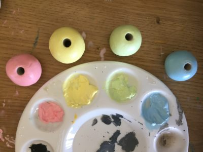 clay beads being painted